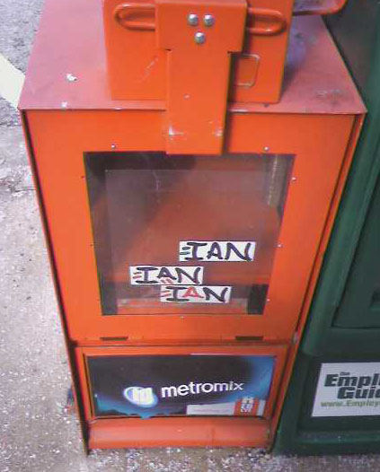 Found on a newspaper distribution box outside the Rogers Park Post Office, on W. Devon Ave.
