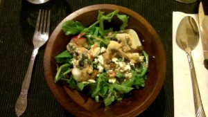 An arugala salad with duck skin cracklings and a duck fat vinegarette